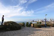 A man looks toward Tel Aviv from the promenade of Jaffa.