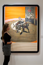 © Licensed to London News Pictures. 14/09/2012. LONDON, UK. A member of Sotheby's staff looks at Francis Bacon's 'Study for a Bullfight No. 1' est. £30,000-50,000 as the New Bond Street auction house prepares for a sale of 'Old Master, Modern and Contemporary Prints'. The auction, set to take place on the 19th of September 2012, features nearly 200 masterful works artists including Andy Warhol, Lucian Freud and Francis Bacon. Photo credit: Matt Cetti-Roberts/LNP