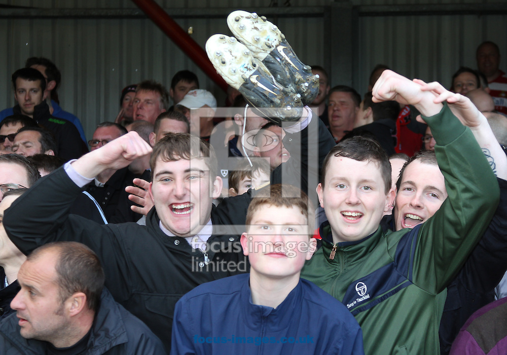 Picture by David Horn/Focus Images Ltd +44 7545 970036.27/04/2013.Happy Doncaster Rovers fans after receiving a player's boots after the npower League 1 match at Griffin Park, London.