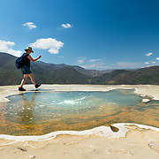 Hiker at mineral spring pool at Hierve el Agua in Oaxaca, Mexico