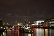 Night scene looking down the River Thames towards London Bridge and HMS Belfast.