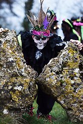 © Licensed to London News Pictures. 21/12/2014. The Beorma Morris perform dances around the ancient stone circle at Rollright Stones in Oxfordshire at sunrise on Winter Solstice, marking the shortest day in the year. Photo credit : Mark Hemsworth/LNP