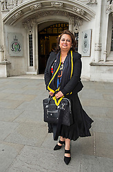 © Licensed to London News Pictures. 08/06/2015. London, UK. VARSHA GOHLI leaving the supreme court together,  where a Supreme Court justice heard the latest round of a multi-million pound divorce cases.  . Photo credit: Ben Cawthra/LNP
