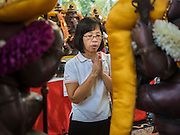 20 SEPTEMBER 2015 - SARIKA, NAKHON NAYOK, THAILAND:  A woman prays at the Ganesh festival at Shri Utthayan Ganesha Temple in Sarika, Nakhon Nayok. Ganesh Chaturthi, also known as Vinayaka Chaturthi, is a Hindu festival dedicated to Lord Ganesh. Ganesh is the patron of arts and sciences, the deity of intellect and wisdom -- identified by his elephant head. The holiday is celebrated for 10 days. Wat Utthaya Ganesh in Nakhon Nayok province, is a Buddhist temple that venerates Ganesh, who is popular with Thai Buddhists. The temple draws both Buddhists and Hindus and celebrates the Ganesh holiday a week ahead of most other places.   PHOTO BY JACK KURTZ