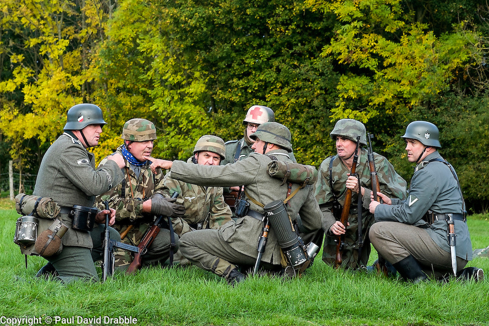 Re-enactors portrayiing panzer grenadiers and fallschirmjäger prepare to take up positions during a battle battle re-enactment on Pickering Showground<br /> <br /> 17/18 October 2015<br />  Image © Paul David Drabble <br />  www.pauldaviddrabble.co.uk