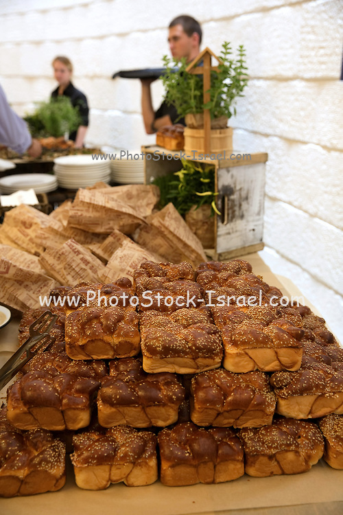 An assortment of freshly baked rolls and loaves of bread on a brunch buffet table