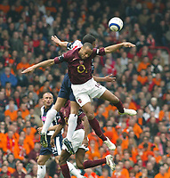 Photo: Chris Ratcliffe.<br />Arsenal v West Bromwich Albion. The Barclays Premiership. 15/04/2006.<br />Thierry Henry of Arsenal goes up for a header with Curtis Davies of West Brom
