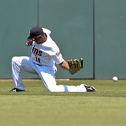 March 13, 2011; Fort Myers, FL, USA; Minnesota Twins center fielder Ben Revere (11) loses a fly ball in the sun during a spring training exhibition game against the Philadelphia Phillies at Hammond Stadium.  Mandatory Credit: Derick E. Hingle-US PRESSWIRE