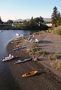 Kayaks sit on the shore of the Napa River during an annual festival in downtown Napa.