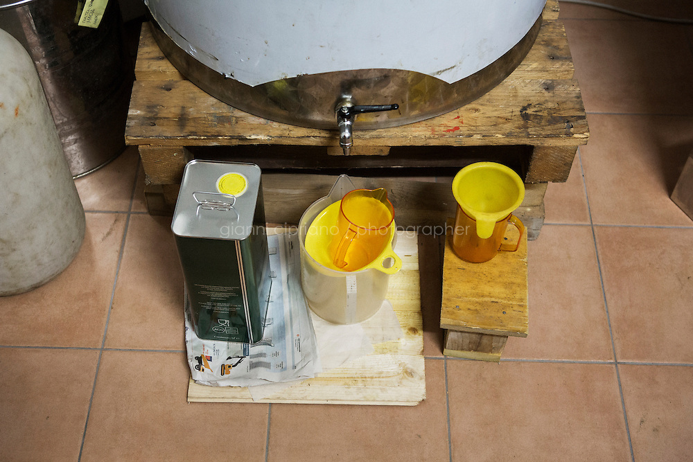 CALENZANO, ITALY - 24 NOVEMBER 2014: Containers and funnels used to store olive oil weren't used this year at the farm of olive oil producer Federico Dufour in Calenzano, 20 kilometers north of Florence, Italy, on November 24th 2014.<br /> <br /> The olive harvest was practically non-existent this fall in Calenzano because of the Bactrocera oleae, an olive fruit fly that this year ravaged entire olive crops. Italy's Institute of Services for Agriculture and Food Market, or ISMEA, calculated that olive oil production fell on average by 35 percent from 302,000 tons from 463,000 the previous year.