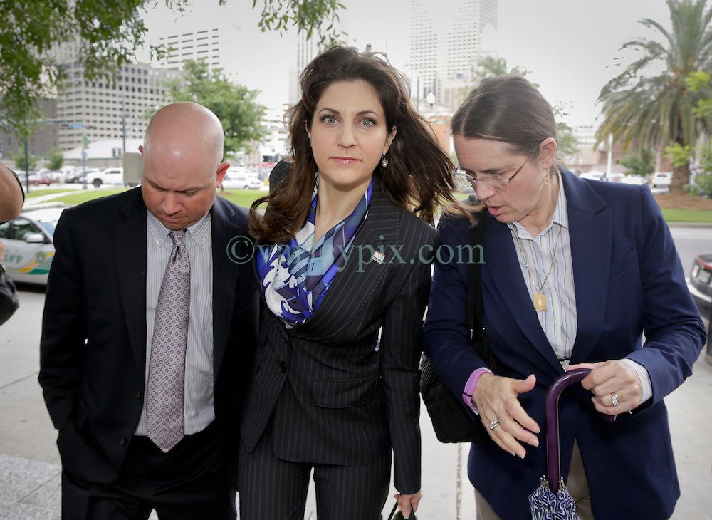 11 June  2015. New Orleans, Louisiana. <br /> L/R Ryan LeBlanc, Rita Benson LeBlanc and their mother Renee LeBlanc prepare for another day at the hearing to determine the competency of grandfather/father Tom Benson. Benson is the billionaire owner of the NFL New Orleans Saints, the NBA New Orleans Pelicans, various auto dealerships, banks, property assets and a slew of business interests. Rita, her brother and mother demanded a competency hearing after Benson changed his succession plans and decided to leave the bulk of his estate to third wife Gayle, sparking a controversial fight over control of the Benson business empire.<br /> Photo©; Charlie Varley/varleypix.com