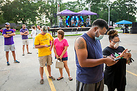 With the Blu Rouge band performing in the parking lot, customers line-up to order food during Cinco de Mayo at Ahuuas Mexican restaurant on Jones Creek Road Tuesday, May 5, 2020 in Baton Rouge, La.