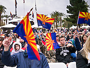 14 FEBRUARY 2012 - PHOENIX, AZ:   People wave Arizona flags during the centennial celebration at the State Capitol in Phoenix, Feb 14. Arizona's statehood day is February 14 and this year Arizona marked 100 years of statehood. It was the last state in the 48 contiguous United States.   PHOTO BY JACK KURTZ