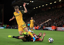 Brighton & Hove Albion's Solly March (left) and AFC Bournemouth's Simon Francis battle for the ball during the Premier League match at the Vitality Stadium, Bournemouth.