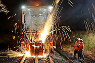 Automated rail maintanence welding work at night.<br /><br />Image protected by copyright.  For usage rights  Contact EFFECTIVE WORKING IMAGE<br /> via our contact page at :<br /> <br /> www.effectiveworkingimage.com