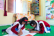 Ritu Gaur, 13, (left) is participating to a Skills Development class focusing on drawing, in the Jamoniya Tank Girls Hostel, near Sehore, Madhya Pradesh, India, where the Unicef India Sport For Development Project has started in 2012. Covering 313 state-run girls' hostels and 207 mixed hostels in Madhya Pradesh, the project ensures that children from Scheduled Tribes (ST) and others amongst the poorest people in India, can easily access education and be introduced to sports. Field workers from Unicef also oversee their nutrition and monitor the overall conditions of each pupil.