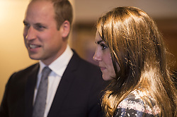 The Duke and Duchess of Cambridge speak with familes receiving support, staff and trustees during a visit to Francis House hospice in Manchester.