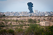 A cloud of smoke rises from Rafah, on the Gaza Strip's border with Egypt, after an Israeli airstrike.
