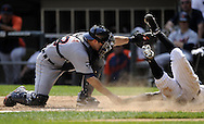 CHICAGO - JULY 27:  Alex Avila #13 of the Detroit Tigers  tags out Juan Pierre #1 of the Chicago White Sox in the seventh inning on July 27, 2011 at U.S. Cellular Field in Chicago, Illinois.  The White Sox defeated the Tigers 2-1.  (Photo by Ron Vesely)  Subject: Alex Avila;Juan Pierre