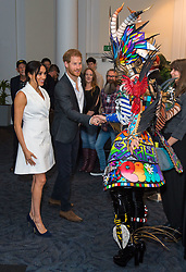 The Duke and Duchess of Sussex meet actors in costume during a visit to Courtenay Creative, in Wellington, on day two of the royal couple's tour of New Zealand.