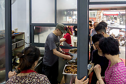 June 13, 2017 - Shanghai, Shanghai, China - Shanghai, CHINA-June 13 2017: (EDITORIAL USE ONLY. CHINA OUT)..People wait in a long line to buy delicious wonton and noodle at a well-known restaurant in Shanghai, June 14th, 2017.Chinese are willing to wait for one hour to enjoy delicious food. (Credit Image: © SIPA Asia via ZUMA Wire)