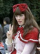 boy dressed up as the red riding hood fairytale girl Japan Harajuku park