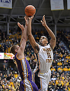 WICHITA, KS - JANUARY 05:  Forward Darius Carter #12 of the Wichita State Shockers puts up a shot against forward Seth Tuttle #10 of the Northern Iowa Panthers during the first half on January 5, 2014 at Charles Koch Arena in Wichita, Kansas.  (Photo by Peter G. Aiken/Getty Images) *** Local Caption *** Darius Carter;Seth Tuttle
