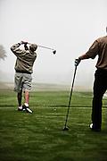 Men Golfing Together
