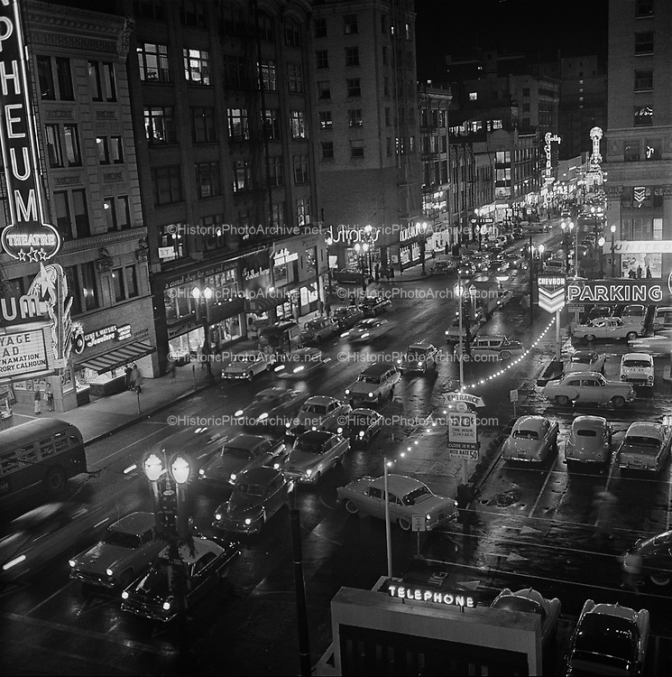 Y-581226A-11.  Night view of SW Broadway looking north from Yamhill. December 26, 1958.