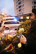 Eliahoo Rouas Cohen and Esther Bekerman light a candle and say prayers for Meryl Bekerman, a hostage who was wounded in the Kosher supermarket<br />