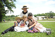 MICHELE WALKER (rear) of Coram; (L to R) ROBERT WALKER, 4; JULIAN LYNN ZOLL, 6, of Levittown; and MADELYN WALKER 7, wear clothes of American Civil War era while portraying family members of Union soldiers at Camp Scott re-creation, at Old Bethpage Village Restoration, to commemorate 150th Anniversary of American Civil War, on Saturday, July 21, 2012, in Old Bethpage, New York, USA.
