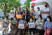 Mothers who have had their children abducted by husbands show support on day seven of Frenchman, Vincent Fichot's  (standing, right) hunger strike outside Sendagaya Station, Tokyo, Japan. Saturday July 17th 2021. Vincent Fichot has not seen his two children since they were abducted by his wife in 2018. He started a hunger strike to put pressure on French President, Emmanuel Macron, who will be attending the 2020 Tokyo Olympic opening ceremony, to raise the issue further with the Japanese government.