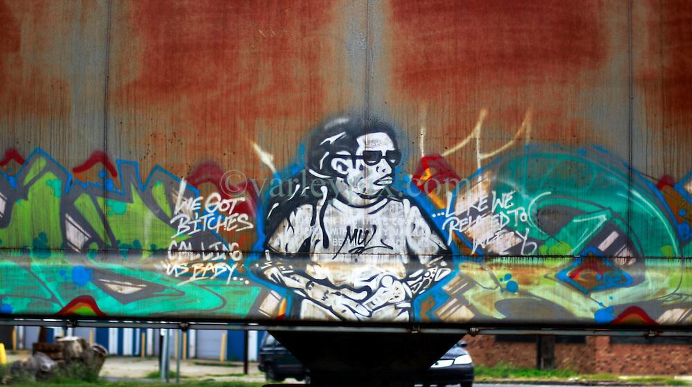 28th August 2014. Arabi, Louisiana.<br /> Graffiti on a passing train.<br /> Photo; Charlie Varley/varleypix.com