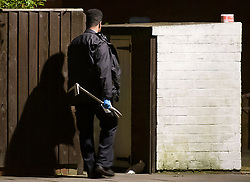 © Licensed to London News Pictures. 20/03/2019. London, UK. A police officer carrying a crow bar outside a property at the scene on Knights Close Hackney, east London where a A 28-year-old man was shot by armed police after reportedly making threats to kill while armed with knives. Photo credit: Ben Cawthra/LNP