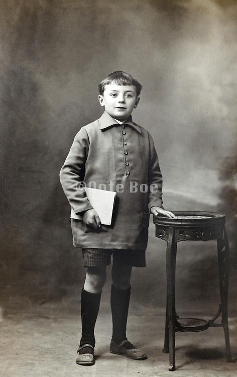 classical vintage studio portrait photo of a full length standing school boy