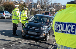 Pictured: PCs Chris Beddows (with speed gun) and Sam Ali were on warning duty today.<br /><br /> Speeding drivers will be stopped by police officers and offered a short education session in a police command unit. Drivers will then be shown a short video featuring Edinburgh schoolchildren who asked the council to help them reduce speeds around their school.