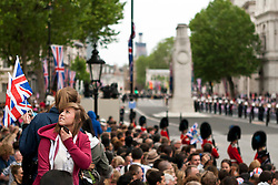 © Licensed to London News Pictures. 05/06/2012. London, UK. A girl is seen looking around Whitehall moments before Queen Elizabeth II rode in the State Landau coach with the Duke and Duchess of Cornwall along Whitehall past the Cenotaph, as part of the Jubilee Procession from Westminster Hall to Buckingham Palace. The Royal Jubilee celebrations. Great Britain is celebrating the 60th  anniversary of the countries Monarch HRH Queen Elizabeth II accession to the throne this weekend Photo credit :James Gourley/LNP