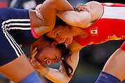 Mcc0041438 . Daily Telegraph..DT Sport..2012 Olympics..India's Geeta Geeta vs Canada's Tonya Lynn Verbeek during the Womens Freestyle Wrestling 55kg 1/8 Finals at the ExCel centre...9 August 2012....
