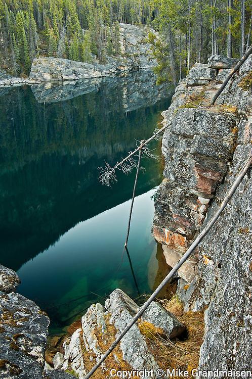 Rocky shoreline at Horseshoe Lake<br /> Jasper National Park<br /> Alberta<br /> Canada