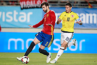 Spain's Gerard Pique (l) and Colombia's James Rodriguez during international friendly match. June 7,2017.(ALTERPHOTOS/Acero)