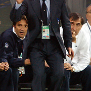 Italian Coach Giovanni Trapattoni organises his players after a second half on slaught by Ecuador