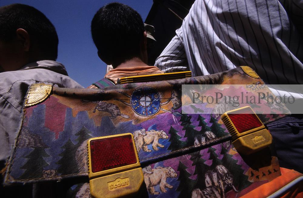 Afghan boy going to school