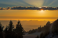 Sunset and god beams from the rim of Crater Lake, Crater Lake National Park, Oregon