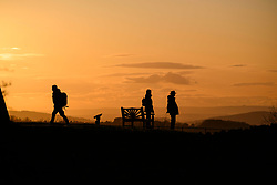 © Licensed to London News Pictures. 07/11/2019. Broadway, Worcestershire, UK. People look out over the Cotswolds from Broadway Hill as the sun sets over the Cotswolds on a cold autumnal evening in Worcestershire. Photo credit: LNP