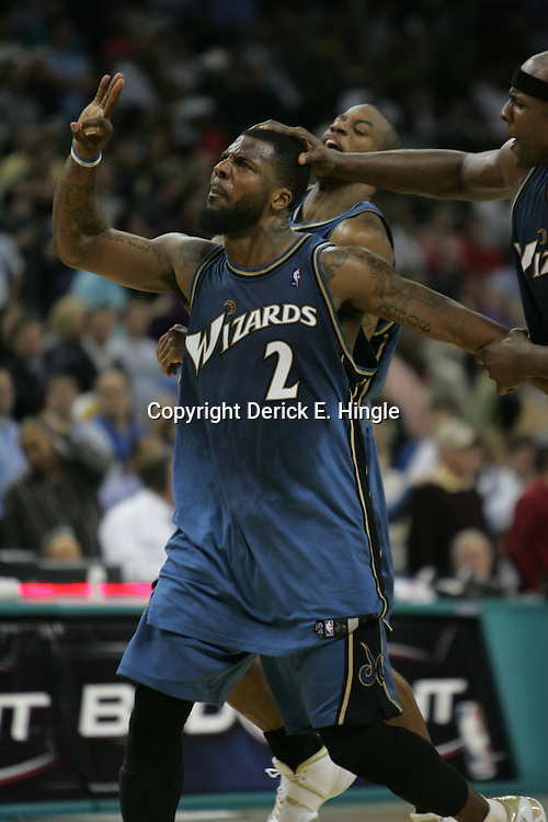 DeShawn Stevenson #2 celebrates his buzzer beater, game winning shot against the New Orleans Hornets that gave the Washington Wizards a 95-92 win on February 25, 2008 at the New Orleans Arena in New Orleans, Louisiana. .