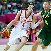 08 August 2012: Russia Alexey Shved drives past Lithuanian Rimantas Kaukenas during 83-74 Team Russia victory over Team Lithuania, during the men's basketball quarter-finals, at the 02 Arena, in London, Great Britain.