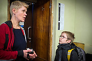 Marina Rassokha, 50, of 'Ukrainian Frontiers', is discussing some of the video she just reviewed with Yaroslav, 10, and his mother Olga, 36, inside a community meeting place in support of internally displaced persons. (IDPs) Yeroslav is taking part to the UNICEF-sponsored One Minute Junior project for internally displaced persons (IDPs), carried out by the local NGO 'Ukrainian Frontiers' in the city of Kharkiv, the country's second-largest, in the east. The conflict between Ukrainian army and Russia-backed separatists nearby, in the Donbass region, have left more than 10000 dead since April 2014, including over 1000 since the shaky Minsk II ceasefire came into effect in February 2015. The approximate number of people displaced by the conflict is 1.4 million as of August 2015. Yeroslav's mother, Olga, is also a participant to a different project of 'Ukrainian Frontiers', called 'Self-Employment', first as a beneficiary, and now as a paid hotline coordinator for people seeking jobs and formation courses.