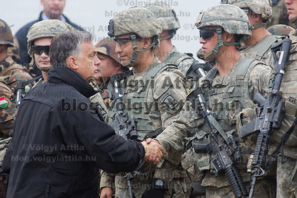 Viktor Orban (L) prime minister of Hungary gratulates participating US soldiers after a joint Hungarian-US military exercise near Osku village (about 92 km South-West of capital city Budapest), Hungary on October 02, 2014. ATTILA VOLGYI