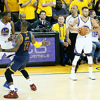 01 June 2017:Cleveland Cavaliers forward LeBron James (23) defends on Golden State Warriors forward Kevin Durant (35) next to Golden State Warriors guard Stephen Curry (30)  during the Golden State Warriors 113-90 victory over the Cleveland Cavaliers, in game 1 of the 2017 NBA Finals, at the Oracle Arena, Oakland, California, USA.