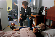 "In a simulated bedroom complete with stuffed animals, tossed bedclothes, and a sleeping dummy victim, Robin R. Murphy of the University of South Florida keeps tabs on her marsupial robot; or, rather, robots. Developed to help search-and-rescue teams, the robots will work as a team. The larger ""mother"" is designed to roll into a disaster site. When it can go no farther, several ""daughter"" robots will emerge, marsupial fashion, from a cavity in its chest. The daughter robots will crawl on highly mobile tracks to look for survivors, feeding the mother robot images of what they see. Although the project is funded by the National Science Foundation and the Defense Advanced Research Projects Agency, Murphy's budget is hardly overwhelming. From the book Robo sapiens: Evolution of a New Species, page 154-155."